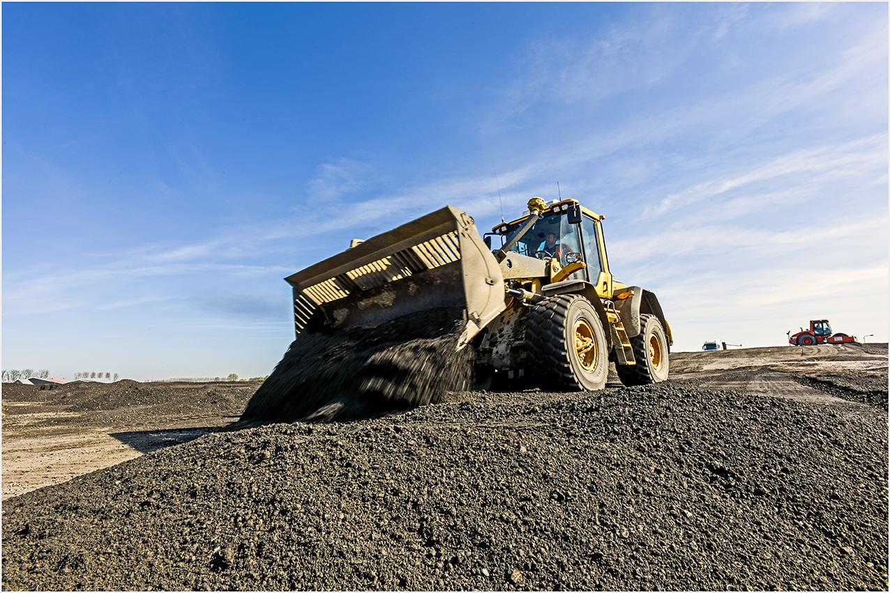 De shovel aan het werk op de bouwplaats Sloeweg, Stanowicki Fotografie